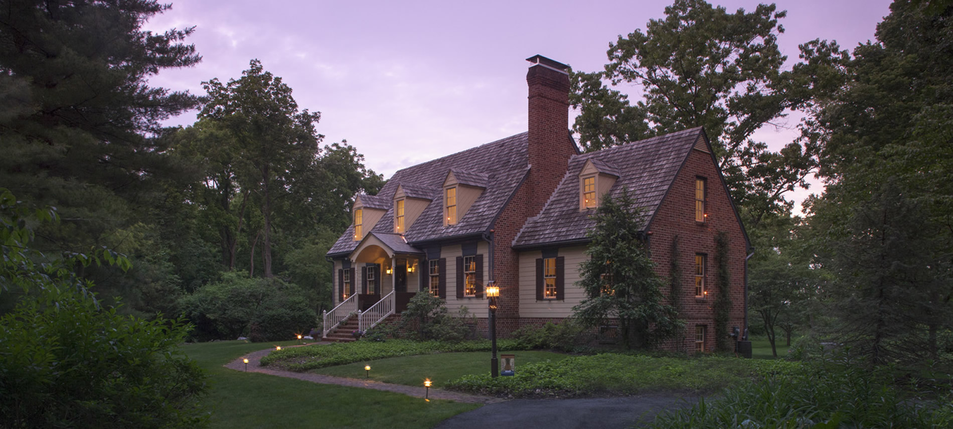 View of House near dark with light on
