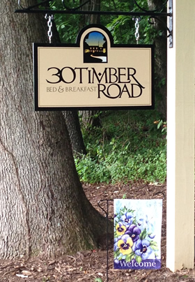 Sign at road entrance for 30 Timber Road B&B
