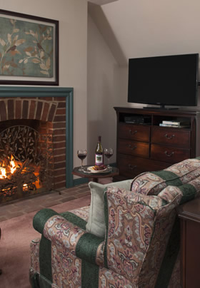 Fireplace aglow in Walnut Room